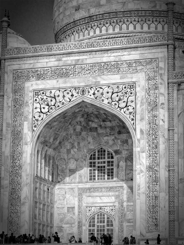black and white Taj Mahal entrance with many visitors