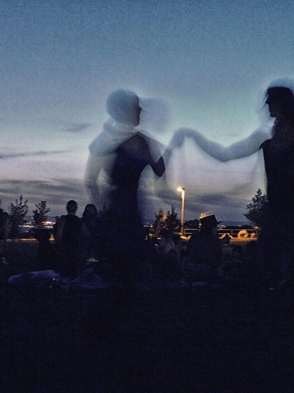 silhouette of couple dancing at twilight