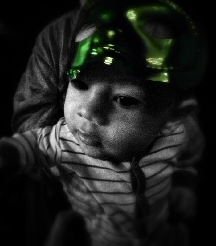 baby with green new years eve mask