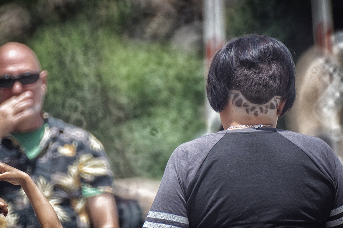 woman with shaved pattern on back of head