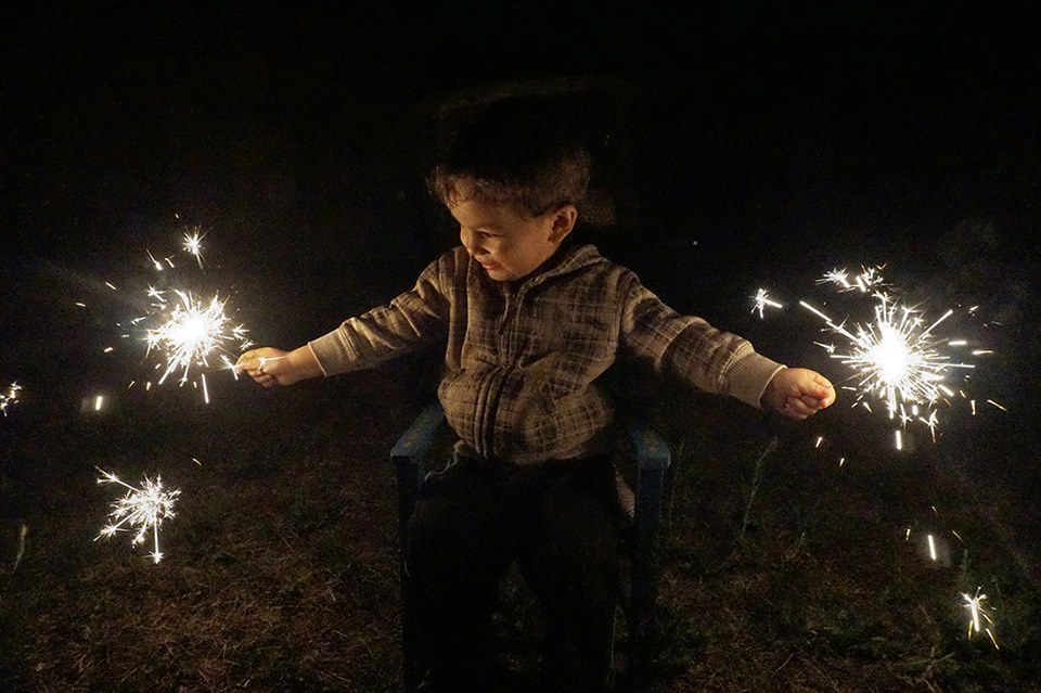 child holds sparklers