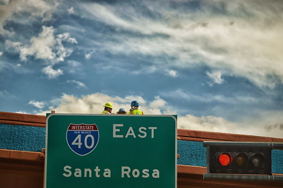 workers on freeway overpass