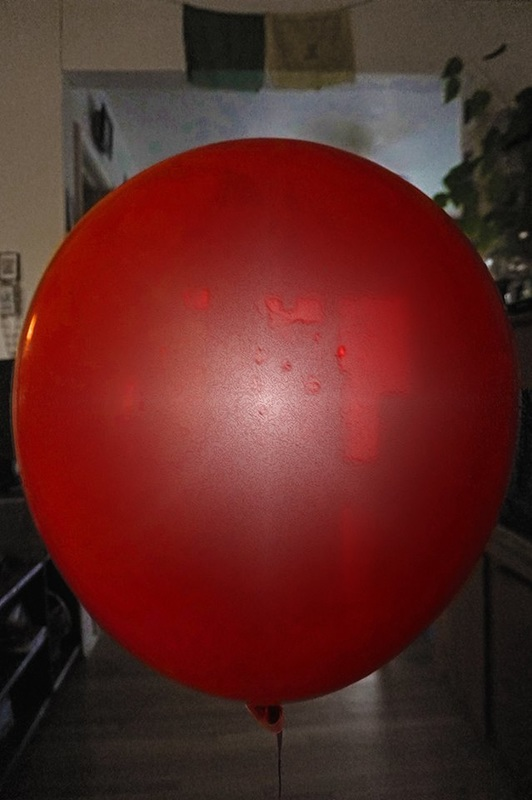 red helium balloon