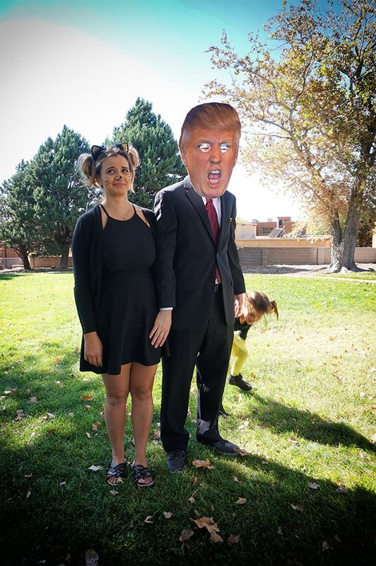 trump mask and black cat costume