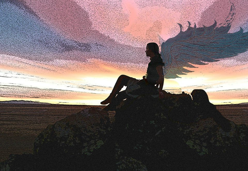 digital image of woman on mountaintop at sunrise with wings