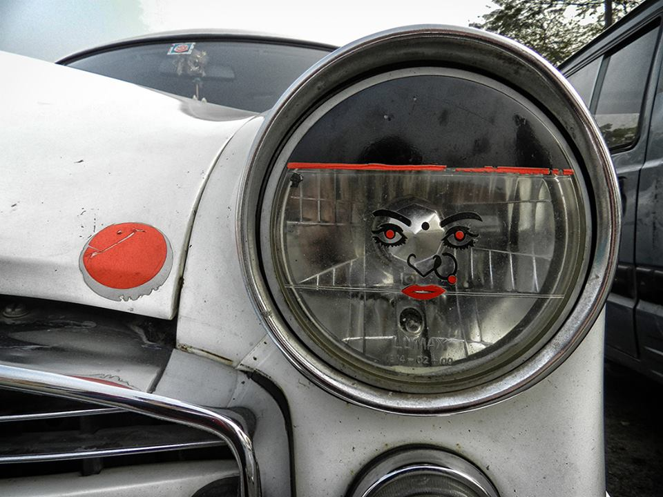 car headlight with woman's face decal
