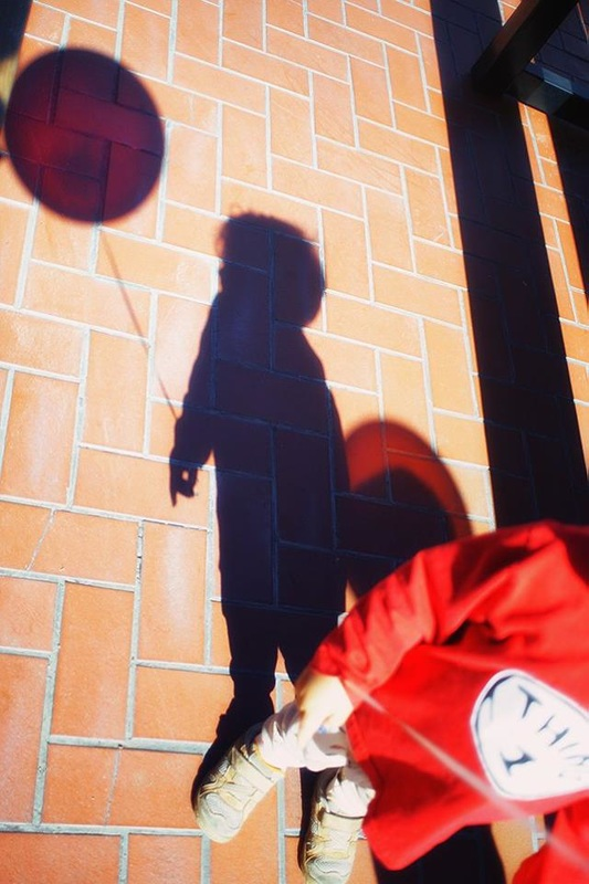 child's shadow with red balloon