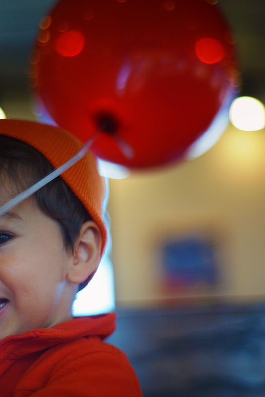 child with red balloon
