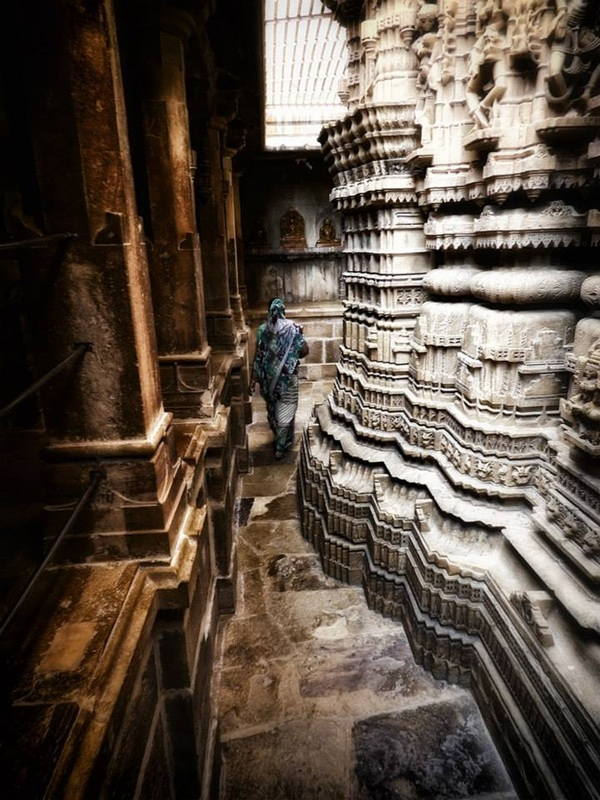 woman walks in Jain temple