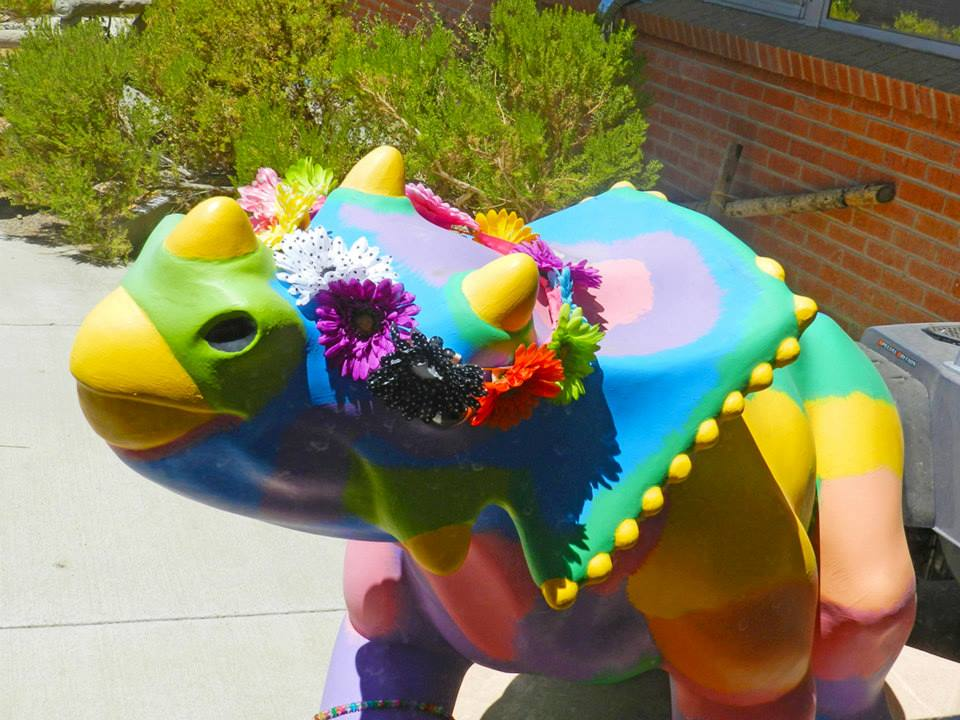 triceratops with flower wreath on head
