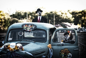 couple celebrates dia de los muertos with truck