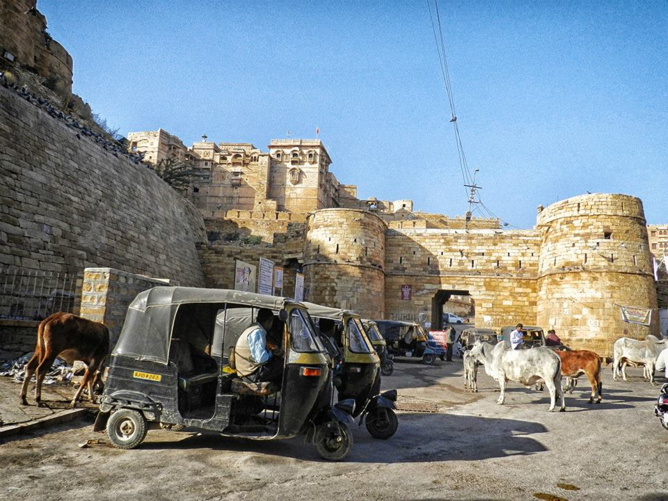 cow and took-took parking outside Jaisalmer fort