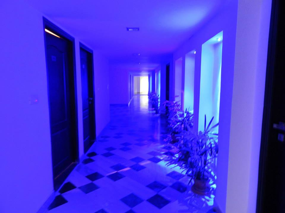 hotel hallway in Agra illuminated by intense blue lights