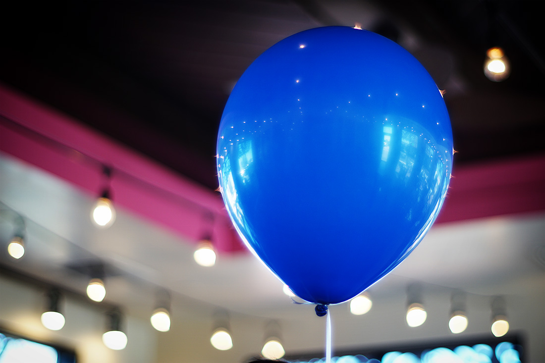 blue balloon with 'sun spots'