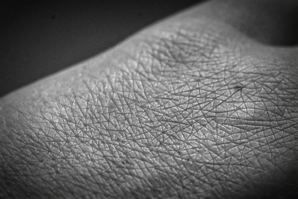 close up human skin black and white