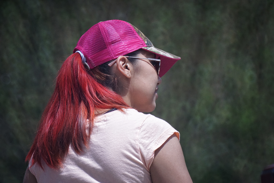 woman with pink cap and red hair