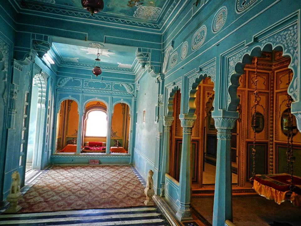 city palace rooms painted in blue and orange