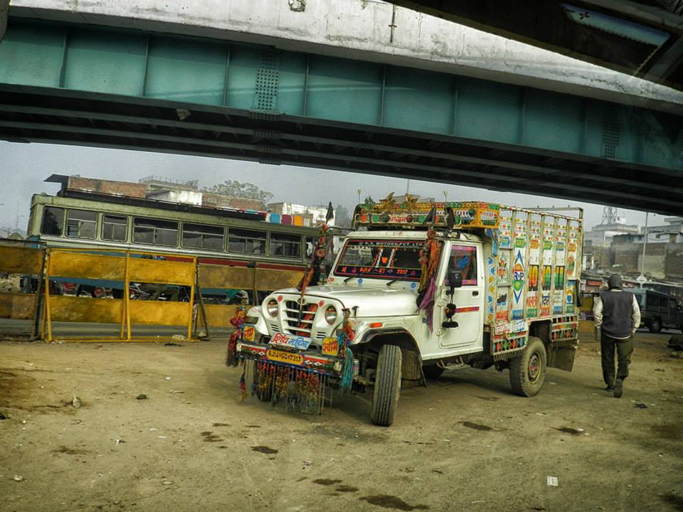 highly decorated truck under overpass