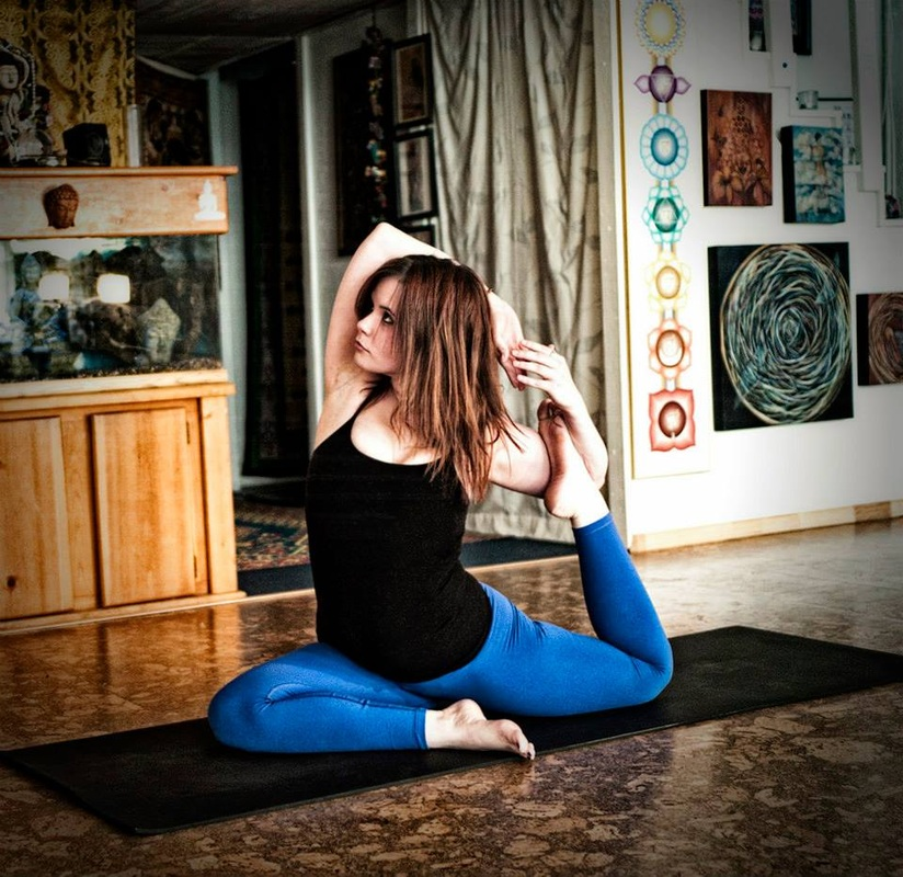 woman in king pigeon yoga posture