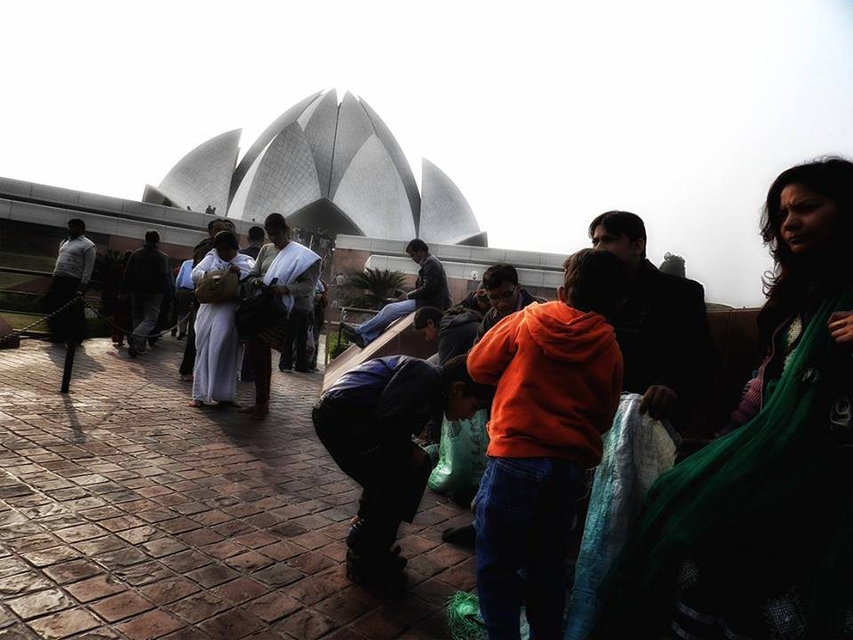 taking off shoes outside the lotus temple