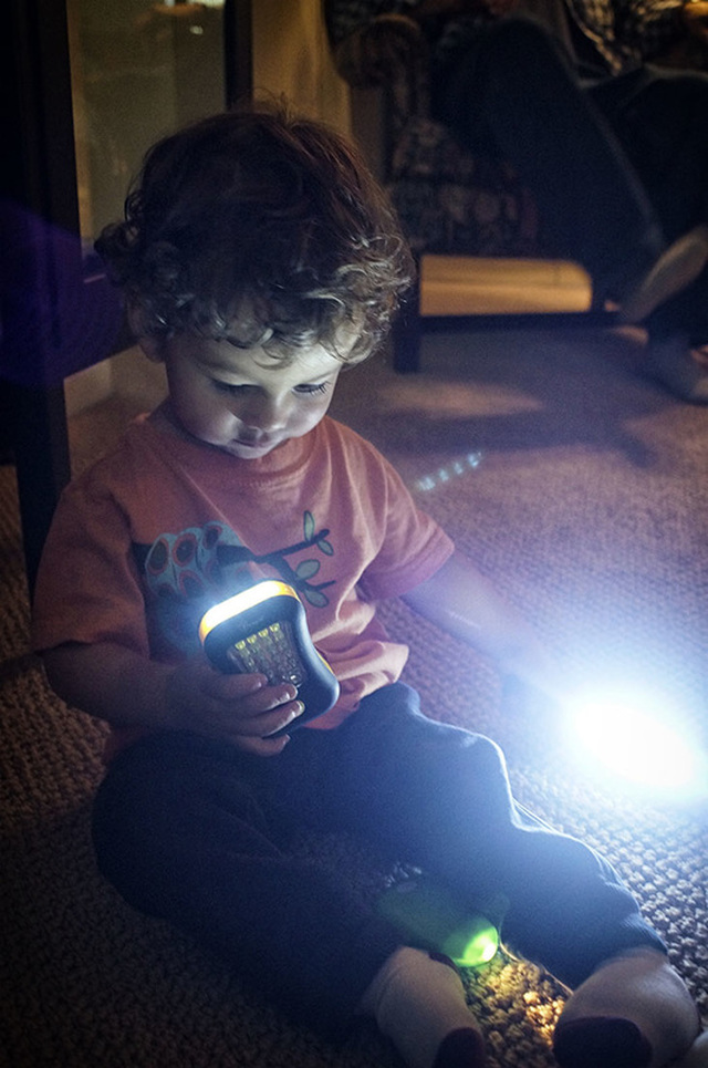 child with flashlights