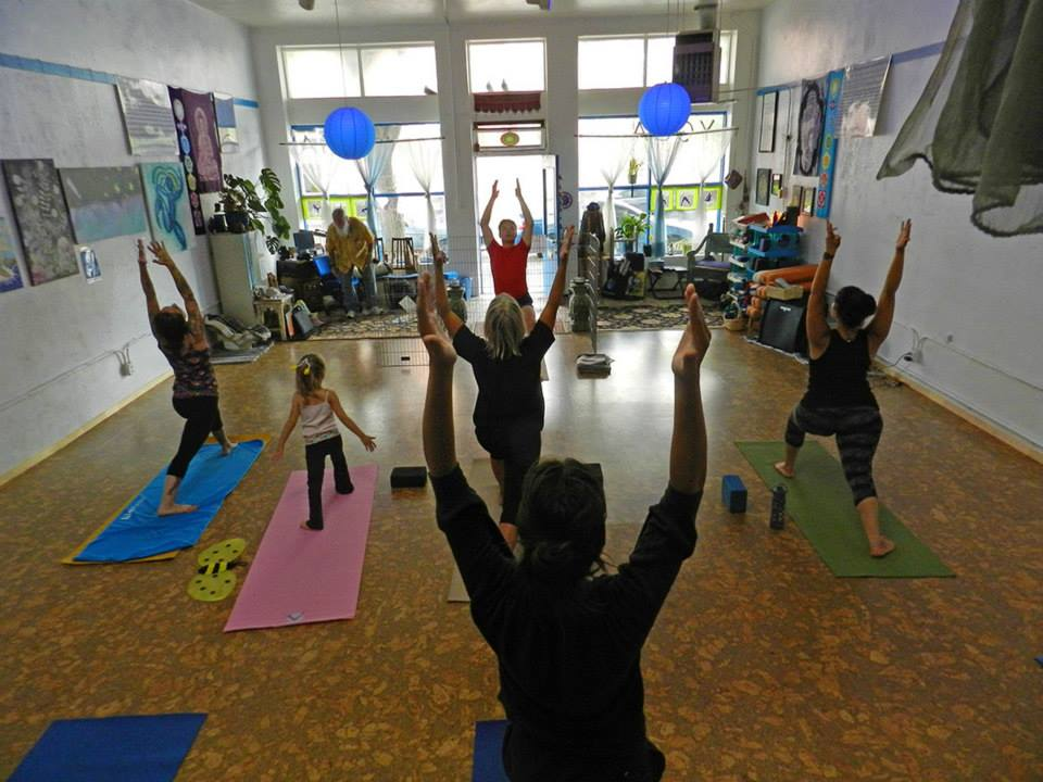 yoga class - students with arms raised