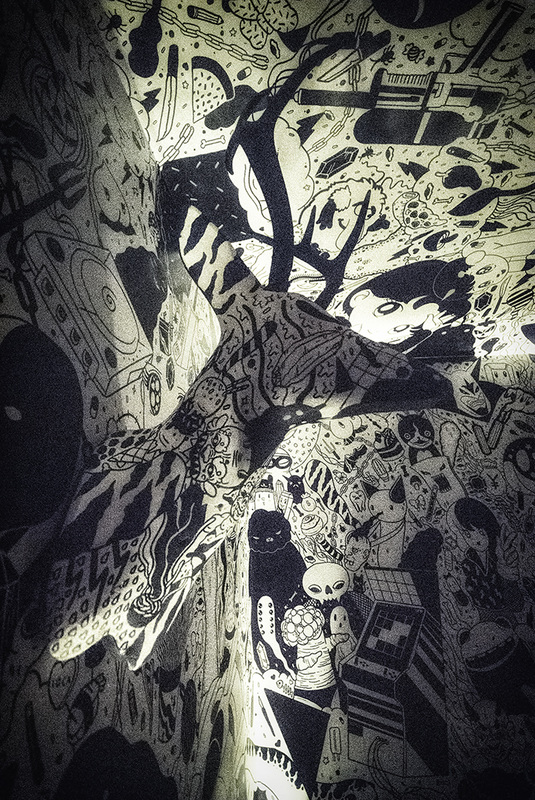 black and white cartoon room with mounted deer head meow wolf