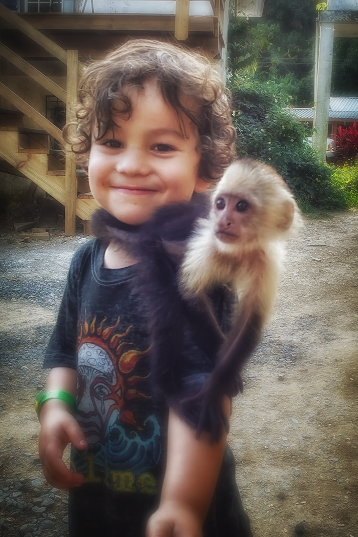 child with capuchin monkey roatan honduras