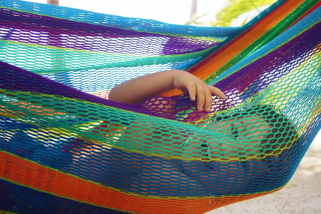 child smiling in hammock