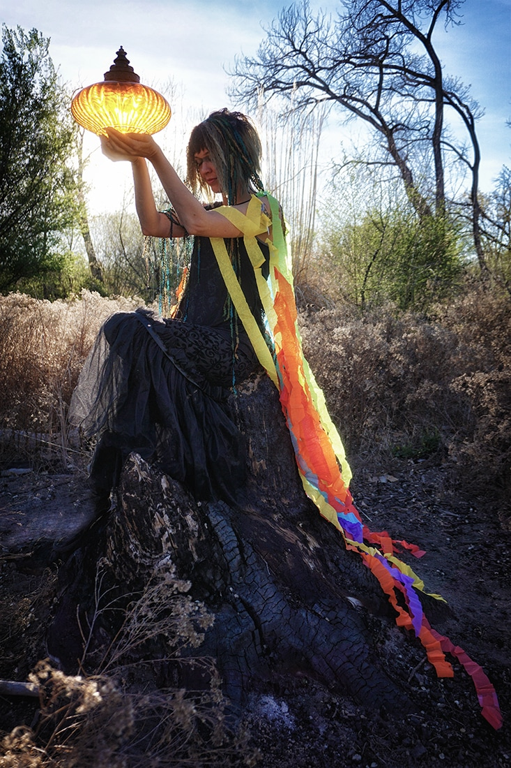 tree spirit offering with color streamers