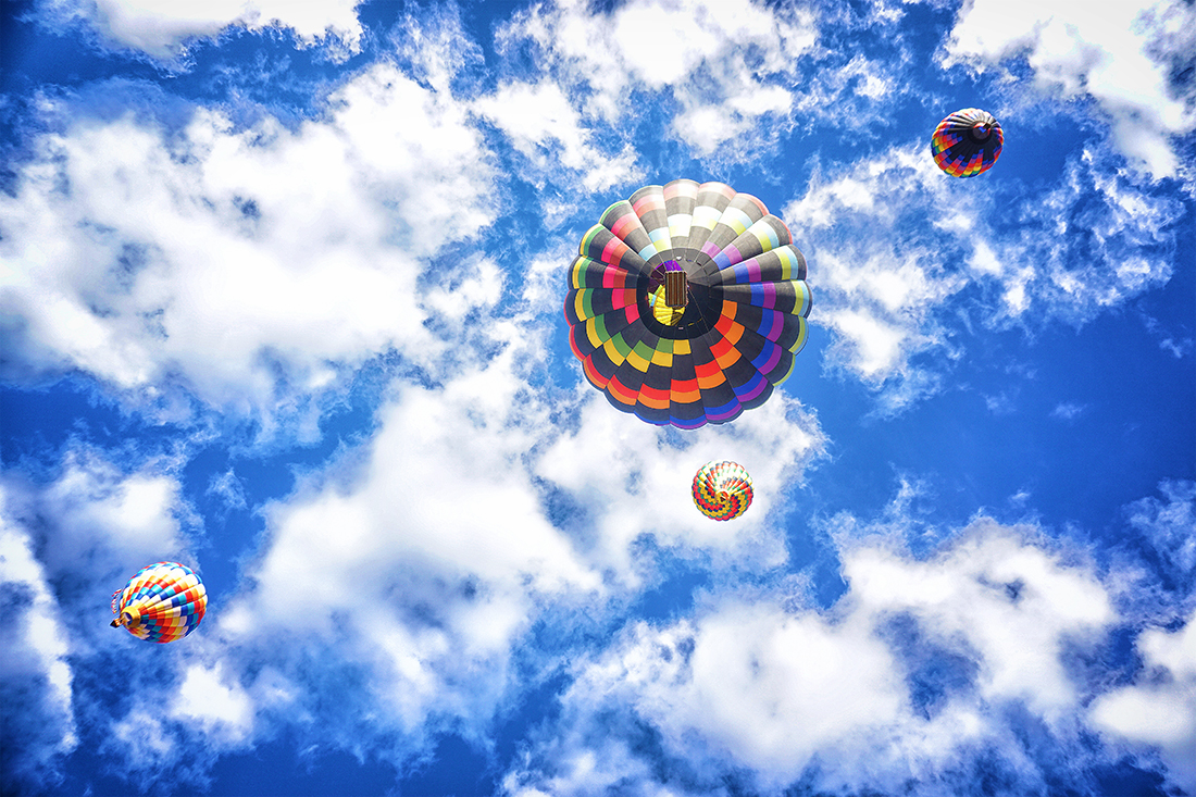 hot air balloons flying directly overhead