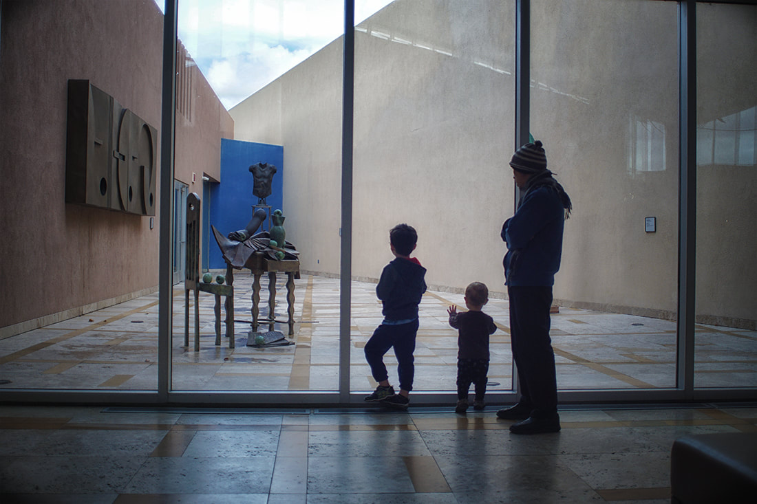 father and sons at art museum
