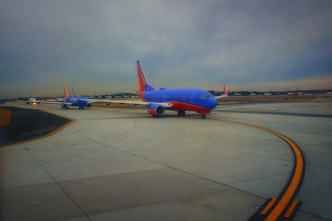 line of southwest airlines planes on runway