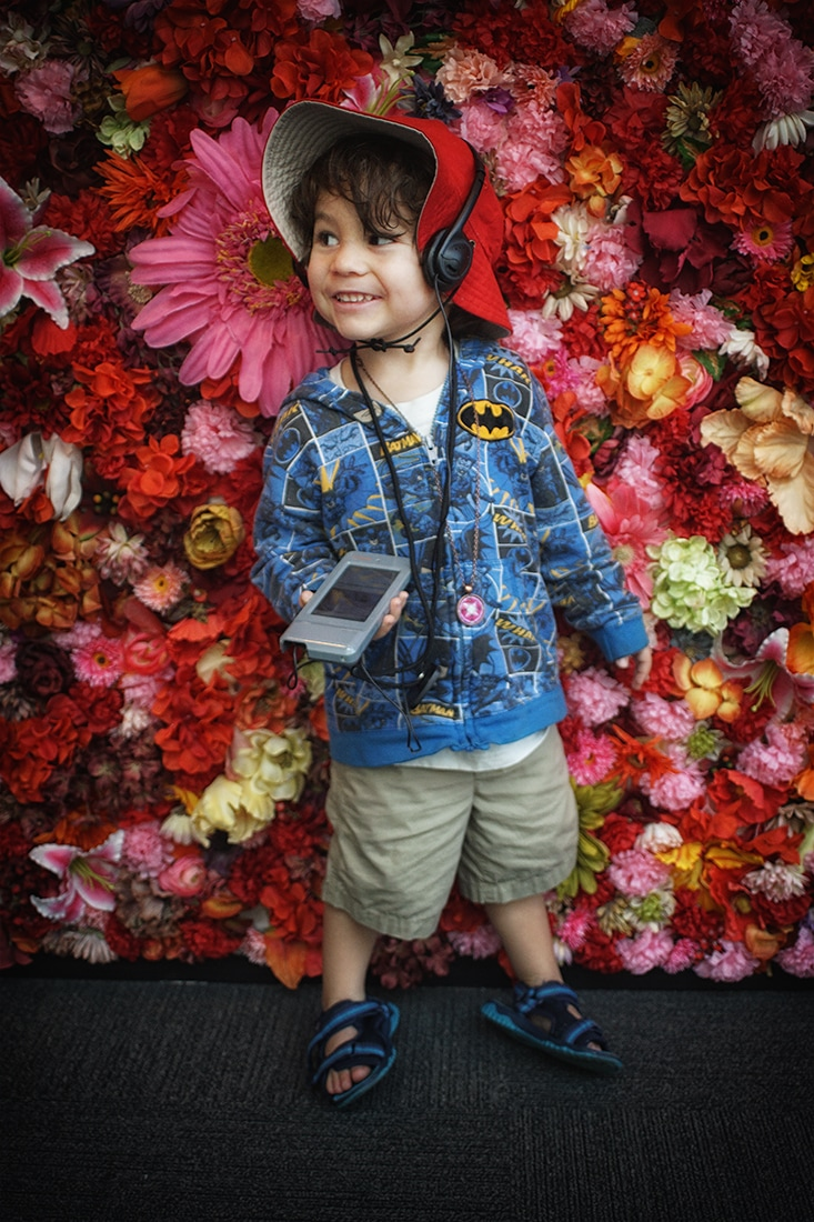child at floral wall entry to frida kahlo exhibit dali museum st petersburg