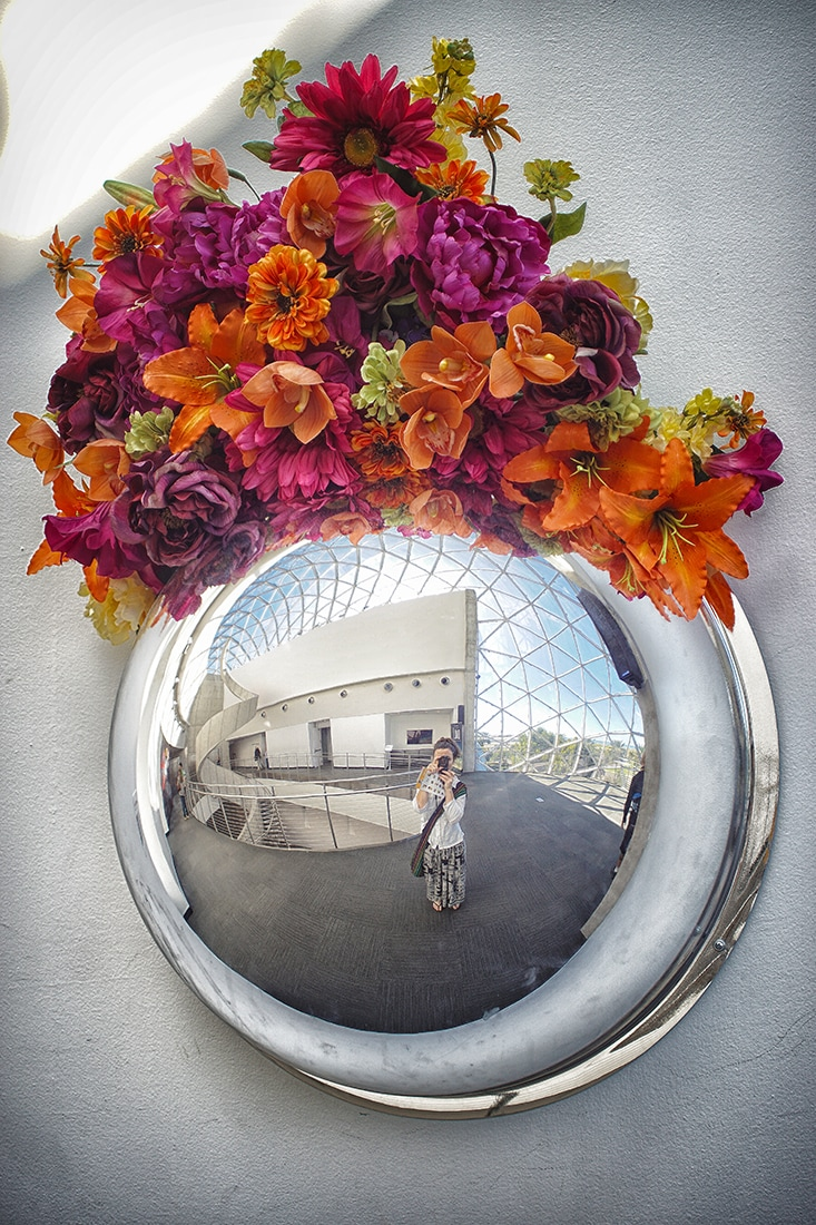 reflecting sphere with flowers on top dali museum st. petersburg
