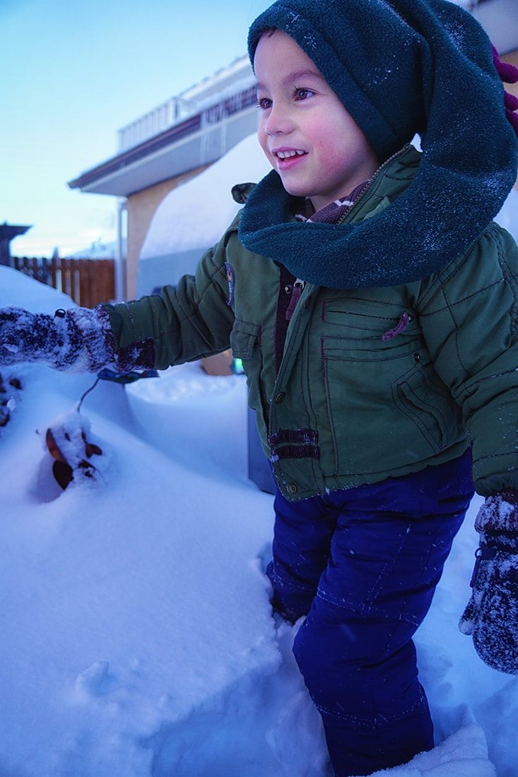 child plays in snow
