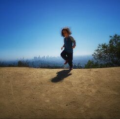child stomps on the city Hollywood hills