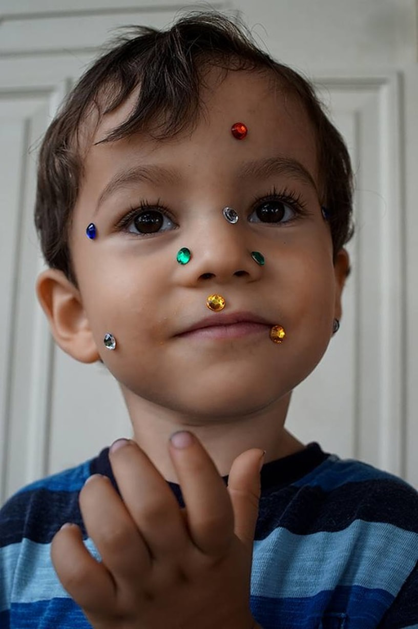 boy with plastic jewels on face