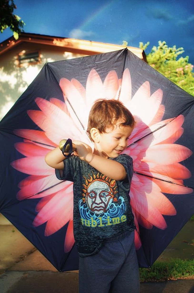 child plays with umbrella