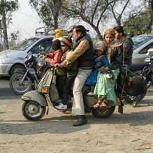 family on scooter in India