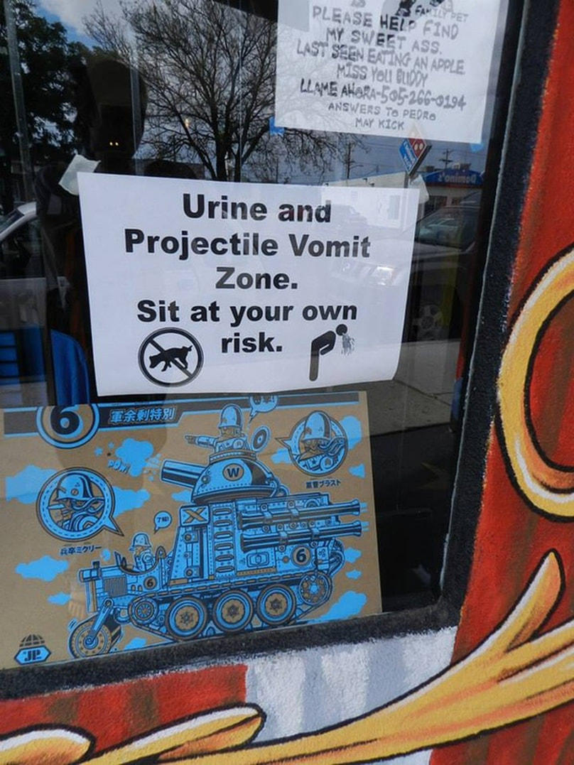 sign in store window: urine and projectile vomit zone. Sit at your own risk.