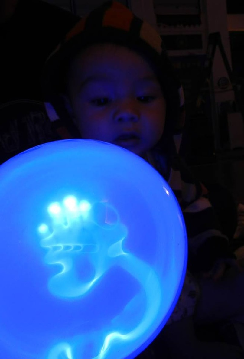 child plays with plasma ball