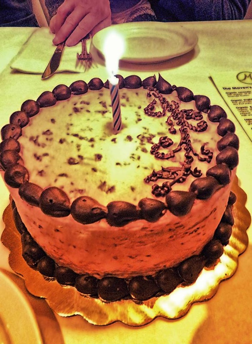 cake with one lit candle