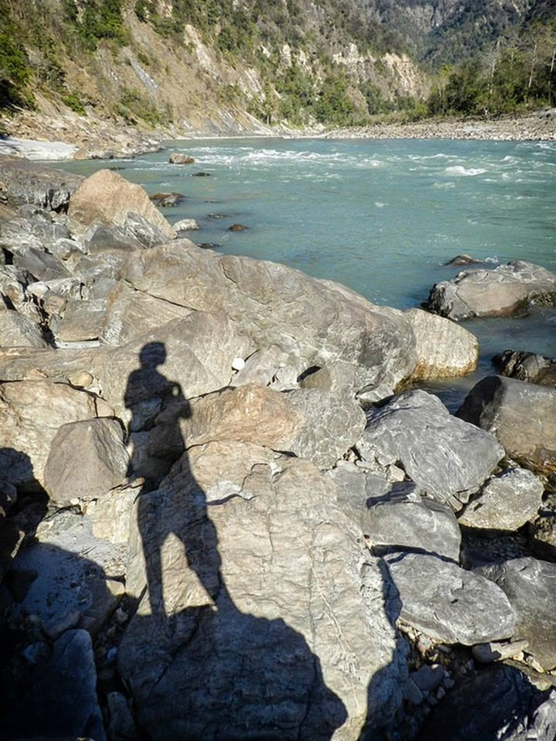 shadow on rocks along ganges self portrait