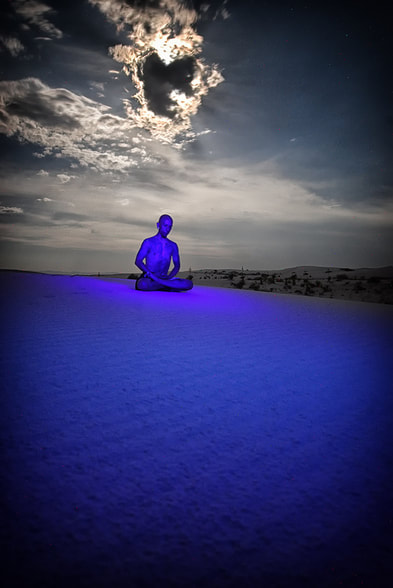 blacklight painted yoga portrait in white sands