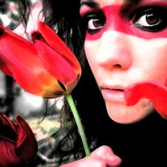 self portrait with red band and tulips